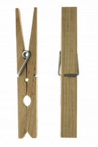 Two isolated wooden clothespins